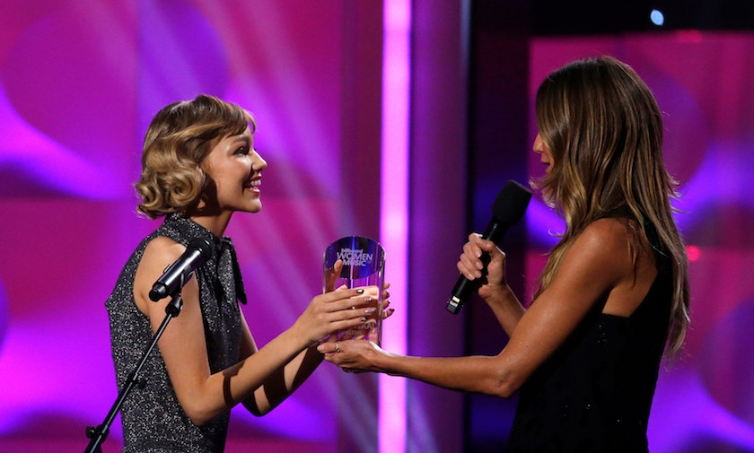 Singer Grace Vander Waal accepts the Rising Star award from model Heidi Klum at the Billboard Women in Music awards in Los Angeles