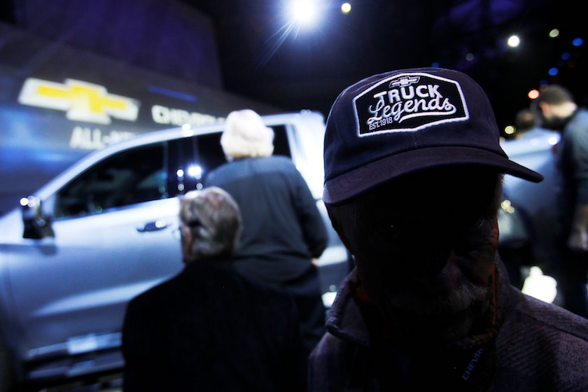 A Chevy truck super-fan known as a Truck Legend wears his hat as Chevrolet unveils new Silverado trucks at the North American International Auto Show in Detroit