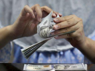 Dollar wavering as global inflation surges; kiwi jumps