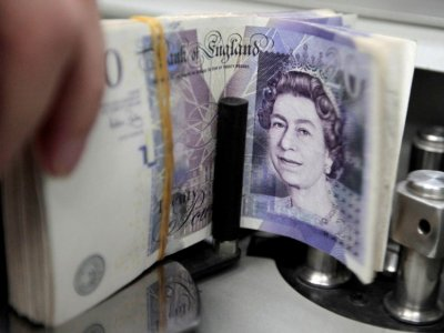 Sterling falls to two-month low ahead of new UK restrictions