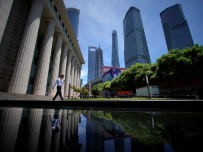 China Q3 GDP growth hits one-year low, raising heat on policymakers