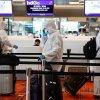 新加坡强制部分入境者     戴电子监控器居家隔离
