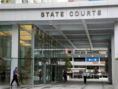 In Singapore, security officer jailed for leaving home to borrow money after testing positive for Covid-19