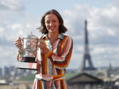 French Open winner Swiatek will quarantine after contact with Covid-19