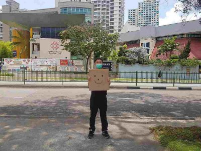 Singapore activist charged for one-man smiley face protest