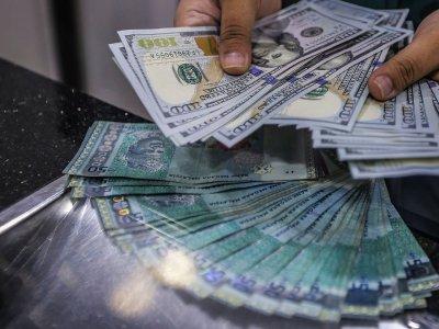 Ringgit ends lower versus greenback on profit taking