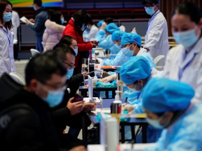 China aims to vaccinate 40pc of population by end-July, says senior adviser