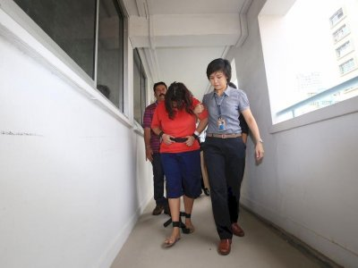 Singapore: Husband of maid abuser is interdicted police officer, also facing charges over maid's death