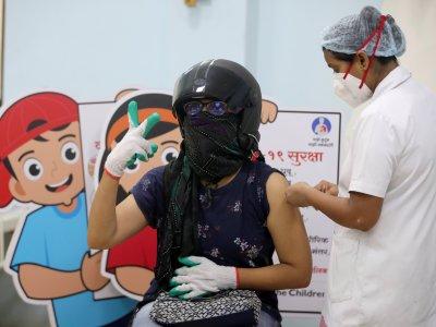 印度南非等60国要求世贸    解禁新冠疫苗专利