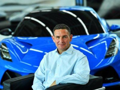 Unveiling its last petrol car, Lotus sets off in pursuit of Porsche