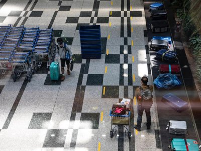 Tighter border measures for travellers from Australia and China's Jiangsu province after rise in Covid-19 cases