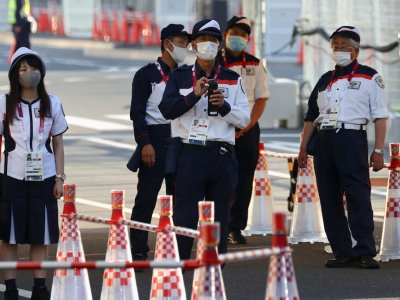 Japan warns of unprecedented Covid spread as Tokyo cases hit new record