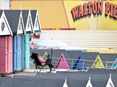 Splash of colour: UK beach huts brighten pandemic gloom