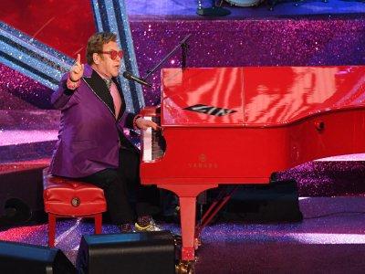 Elton John delays farewell tour after hip injury