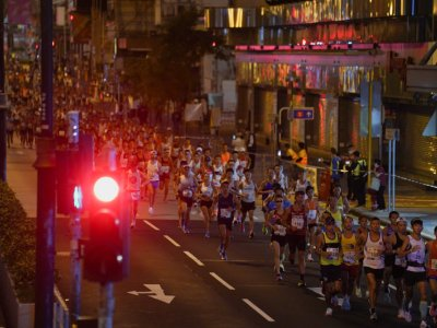 Reports: Hong Kong Marathon runners forced to change, cover 'political' slogan