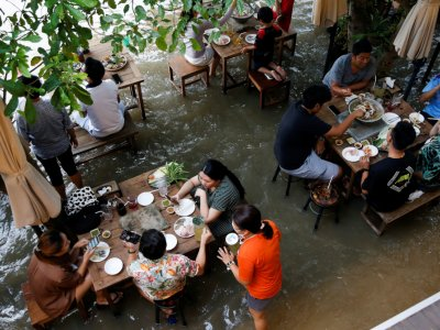 Flood dining goes viral in Thailand
