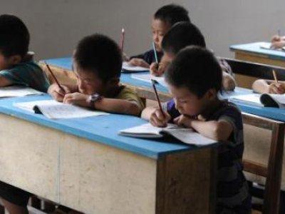 China passes law to cut kids' homework, tutoring pressures