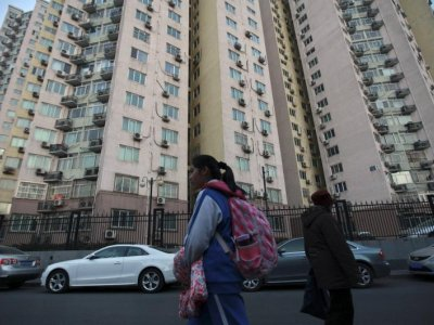 China to expand property tax trial to check speculation