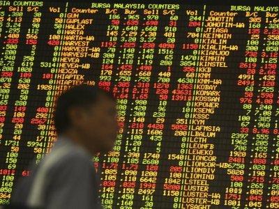 Bursa Malaysia lower at mid-day, bucks regional trend