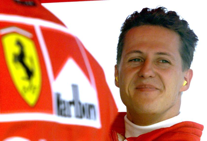 Germany's Michael Schumacher smiles in the pit area after completing his second qualifying session of the Hungarian Formula One Grand Prix in this August 15, 1998 file photo. — Reuters pic
