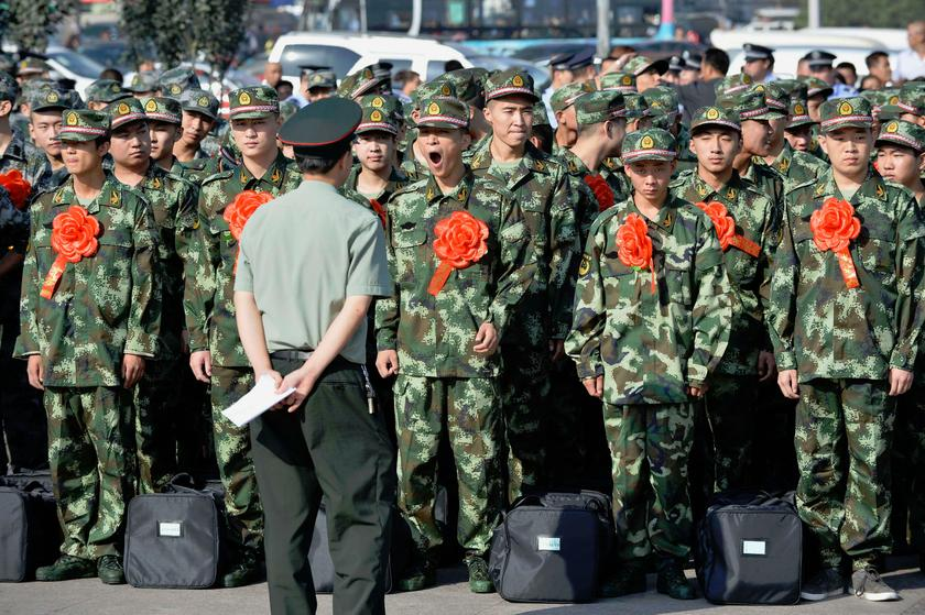 China's People Liberation Army (PLA) soldiers wait outside a railway station in Taiyuan in this file picture taken on September 10, 2013. — Reuters pic