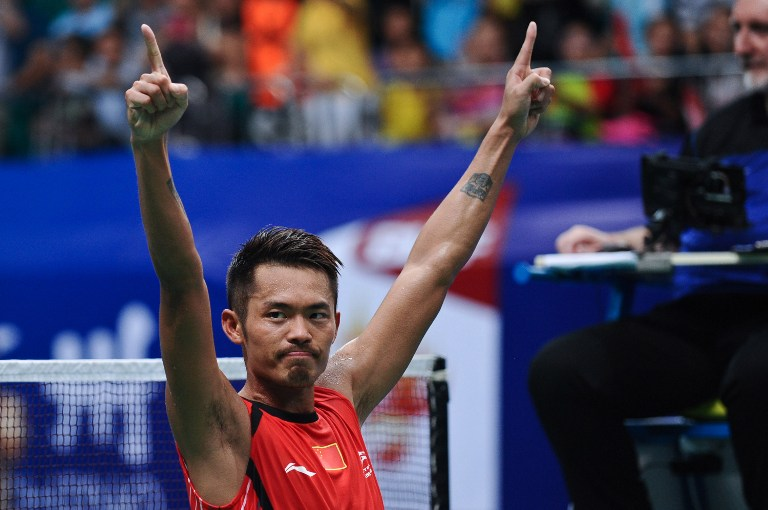 China's Lin Dan celebrates after winning his men's singles final against Malaysia's Lee Chong Wei at World Badminton Championships in Guangzhou, south China's Guangdong province on August 11, 2013. — AFP pic