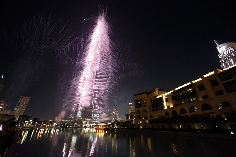 Fireworks illuminate the sky around Dubai's Burj Khalifa, the world's tallest tower, November 27, 2013, after the Emirati city was chosen to host the World Expo 2020. ― AFP pic
