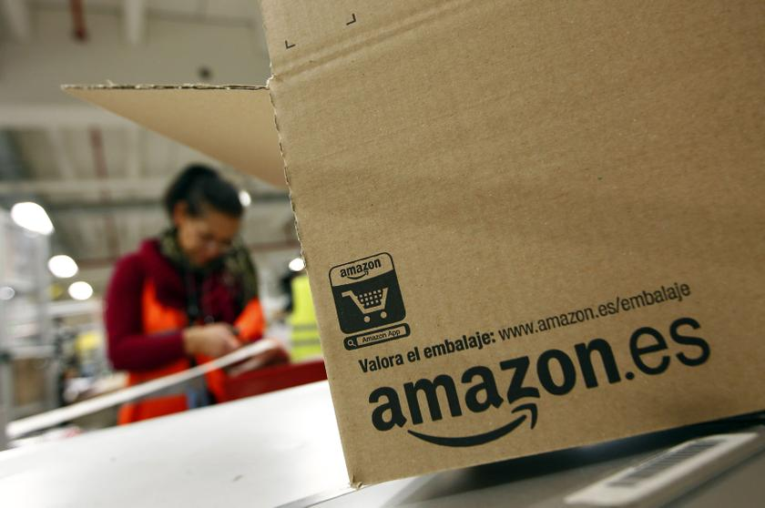 A worker packs a box at Amazon's logistics centre in Graben near Augsburg in this December 16, 2013 file picture. — Reuters pic