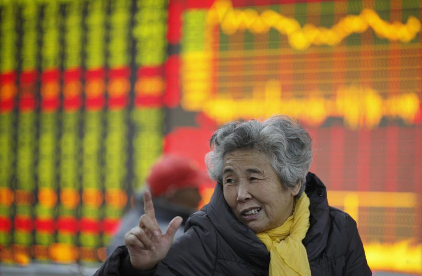 An investor gestures in front of an electronic board showing stock information at a brokerage house in Huaibei, Anhui province. Asian markets sank today after Donald Trump failed to give investors enough reassurance over the progress of China trade talks and as violent Hong Kong protests show no sign of letting up. — Reuters pic