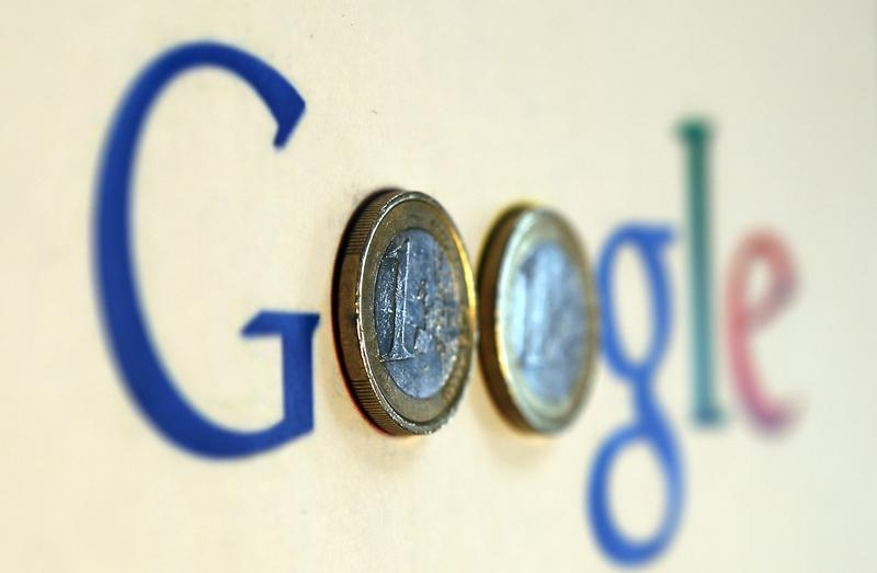 An illustration picture shows a Google logo with two one Euro coins, taken in Munich January 15, 2013. — Reuters pic