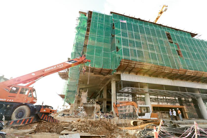 The local property sector came to a near standstill in the past six months, with few property launches and no large-scale projects taking place. — File pic