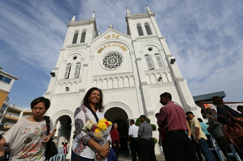 Datin Paduka Marina Mahathir stands outside the Church of Our Lady of Lourdes in Klang, Selangor, January 5, 2014. — Picture by Saw Siow Feng