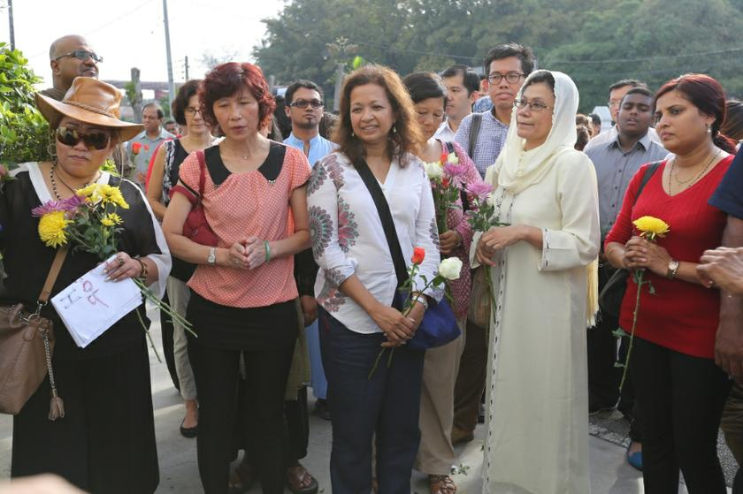 Datin Paduka Marina Mahathir stands with other concerned Malaysians outside the Church of Our Lady of Lourdes in Klang, Selangor, January 5, 2014. — Picture by Saw Siow Feng