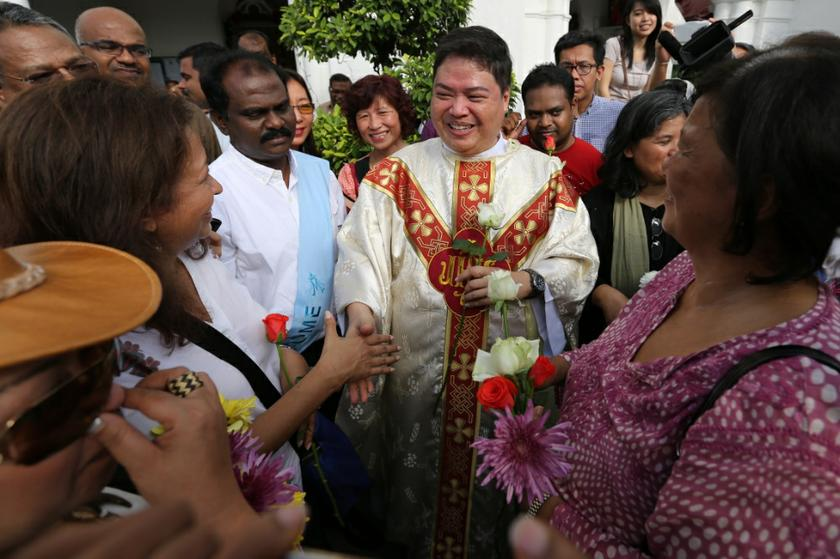 Rev Father Michael Chua greets Datin Paduka Marina Mahathir outside the Church of Our Lady of Lourdes in Klang, Selangor, January 5, 2014. — Picture by Saw Siow Feng