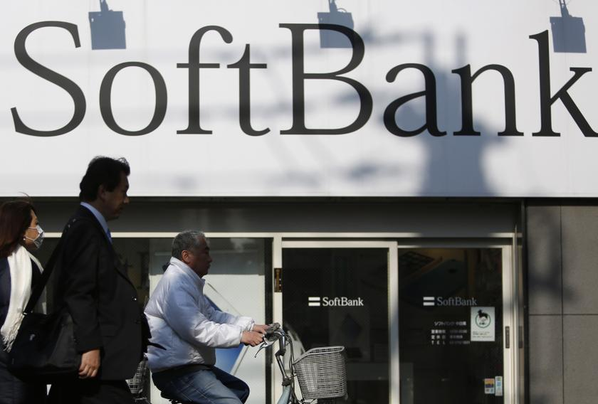 Pedestrians walk in front of a SoftBank Corp logo outside its branch in Tokyo February 25, 2014. — Reuters pic