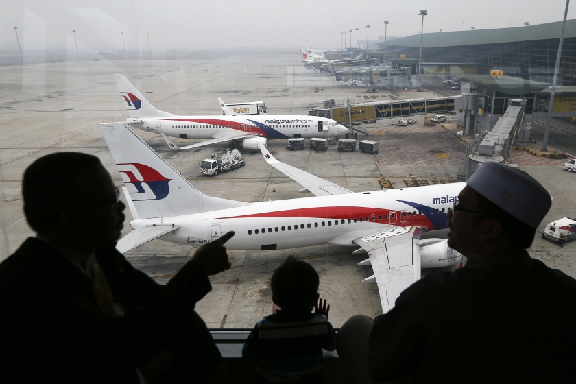 A passenger takes pictures of a Malaysia Airlines plane at the Kuala Lumpur International Airport March 16, 2014. — Reuters file pic