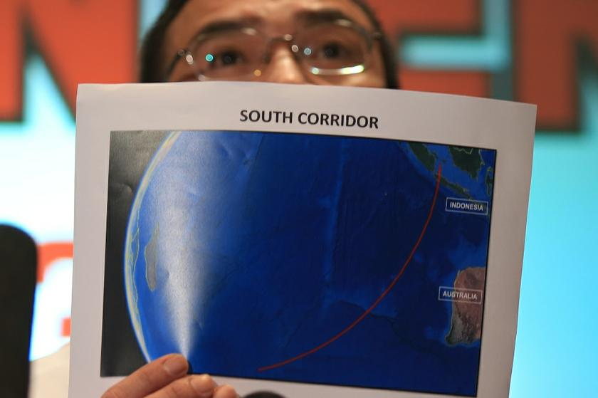 Defence and Acting Transport Minister Datuk Seri Hishammuddin Hussein holding a map showing the southern corridor at the daily MH370 press conference at the Sama Sama Hotel in KLIA, on March 17, 2014. — Picture by Saw Siow Feng