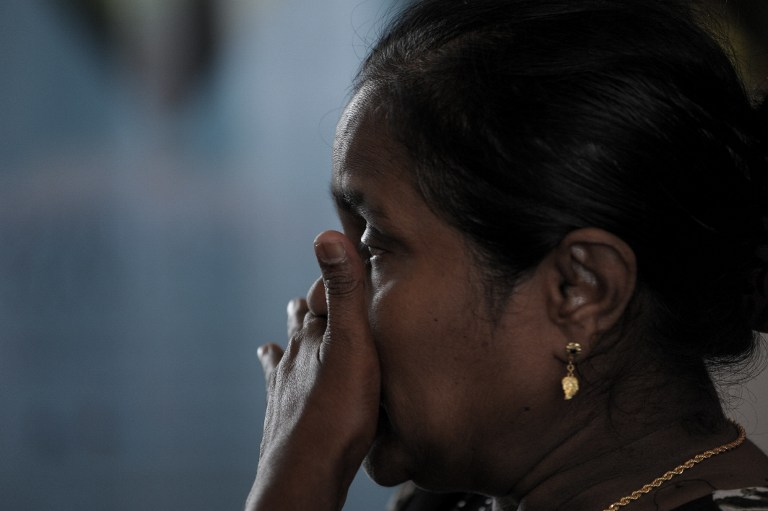 A relative of victims from the missing Malaysia Airlines Boeing 777-200 plane cries while awaiting updates at a hotel in Putrajaya, outside Kuala Lumpur March 10, 2014. — AFP pic