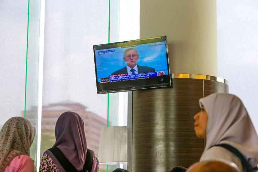 John Young, general manager of the emergency response division of the Australian Maritime Safety Authority (AMSA), shown on TV as he speaks about satellite imagery of debris possibly from Malaysia Airlines flight MH370 in Putrajaya March 20, 2014. — Reuters pic