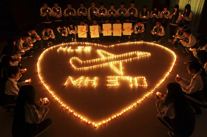 International school students light candles to pray for passengers aboard Malaysia Airlines flight MH370, in Zhuji, Zhejiang province, March 10, 2014. — Reuters file pic