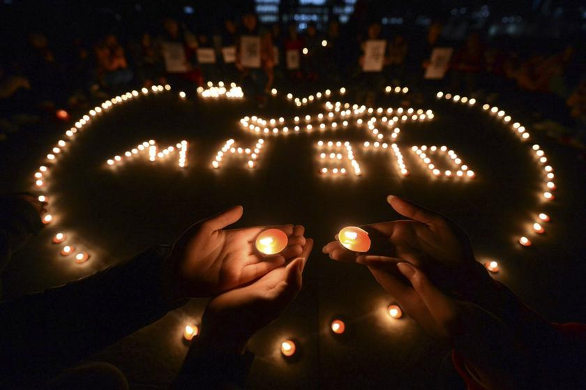 College students light up candles as they pray for passengers of the missing Malaysia Airlines MH370 plane in Yangzhou, Jiangsu province, March 13, 2014. — Reuters pic