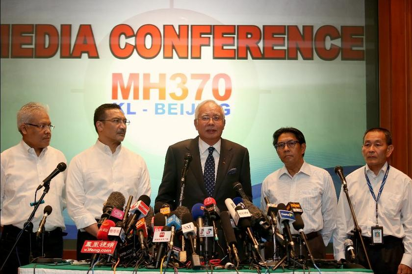 Prime Minister Datuk Seri Najib Razak (centre) said today that the missing Malaysia Airlines flight MH370 may be between two possible corridors that span from Kazakhstan to Thailand in one and Indonesia to the south of the Indian Ocean in the other. ― Picture by Saw Siow Feng