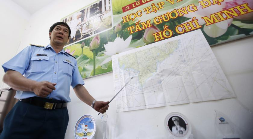 Vietnam's Air Force Deputy Chief of Staff Senior Colonel Do Duc Minh points to the map of a search area to find the missing Malaysia Airlines flight MH370, during a news briefing at a military airport in Ho Chi Minh city March 13, 2014. —Reuters pic