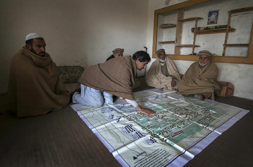 Local elders point to their fruit orchards on a map showing lands, taken over by the army for a base, in the town of Khwazakhela in the northwestern Swat valley February 4, 2014. — Reuters pic