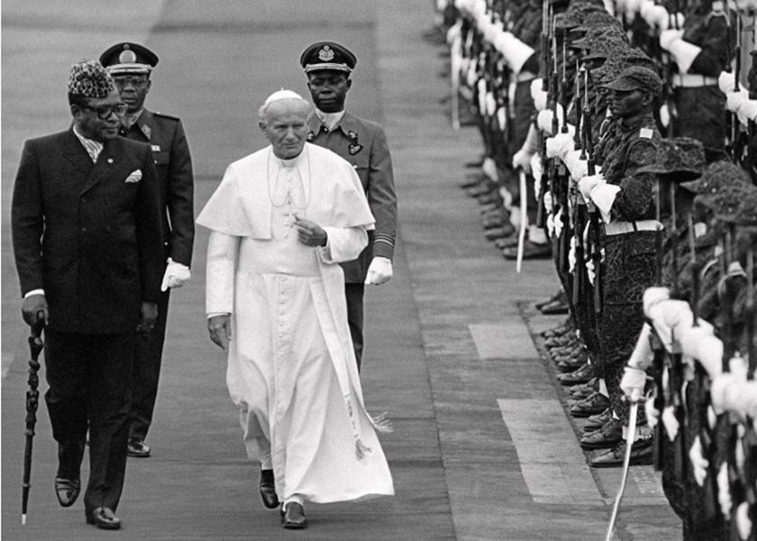 Pope John Paul II accompanied by Zaire President Mobutu Sese Seko in Kinshasa, 14 August, 1985. — AFP pic