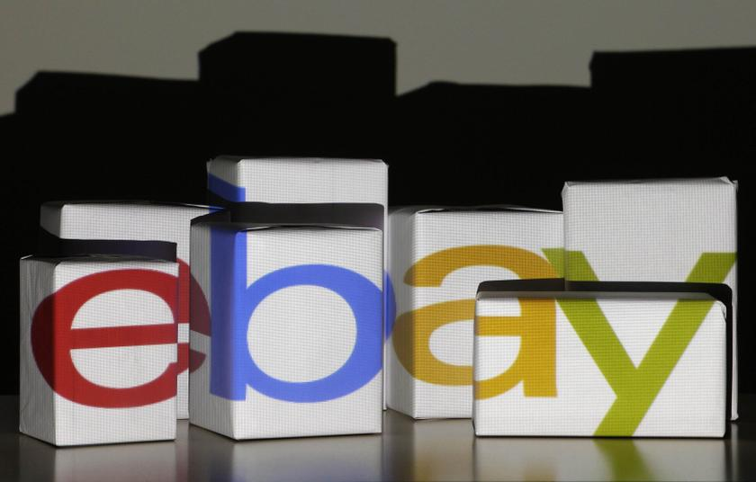 An eBay logo is projected onto white boxes in this illustration picture taken in Warsaw, January 21, 2014 Reuters