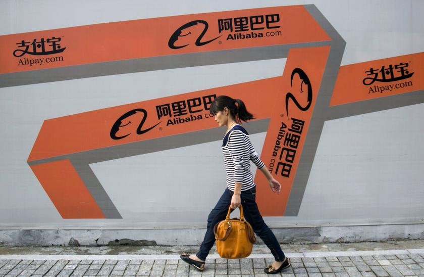 A woman walks past an Alibaba advertisement on a wall in Hangzhou, Zhejiang province, in this file picture taken September 26, 2013. — Reuters pic