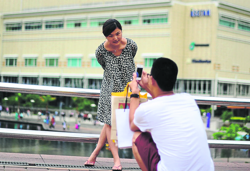 File photo of tourists from China taking pictures at the Kuala Lumpur City Centre. Matta said Malaysia could climb up and become a tourist powerhouse holiday destination if the government grants visa-free travel for tourists particularly from China and India. — Picture by Arif Kartono