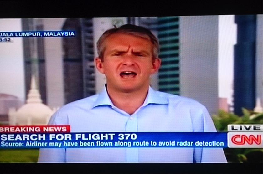 A video-grab shows CNN's senior international correspondent Nick Robertson reporting live from Kuala Lumpur in a breaking news report on MH370.