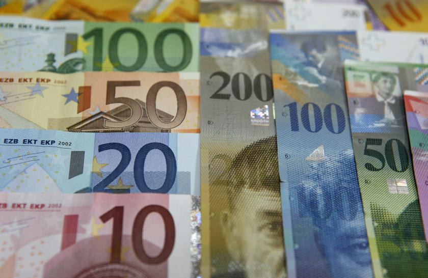 File photo illustration of various Euro banknotes lying next to various Swiss Franc notes at a bank in Warsaw, July 18, 2011. — Reuters pic